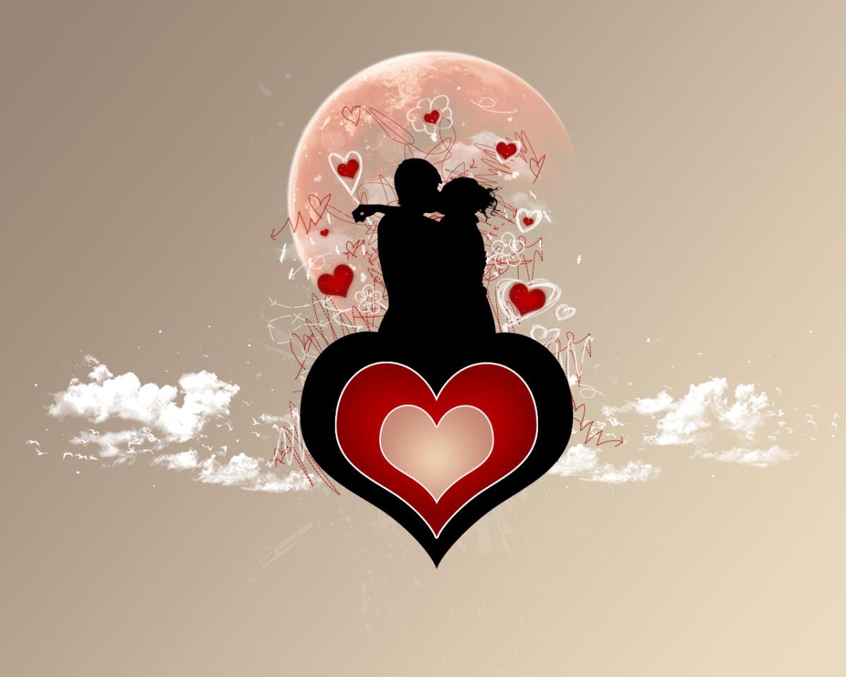couple kissing on a heart image