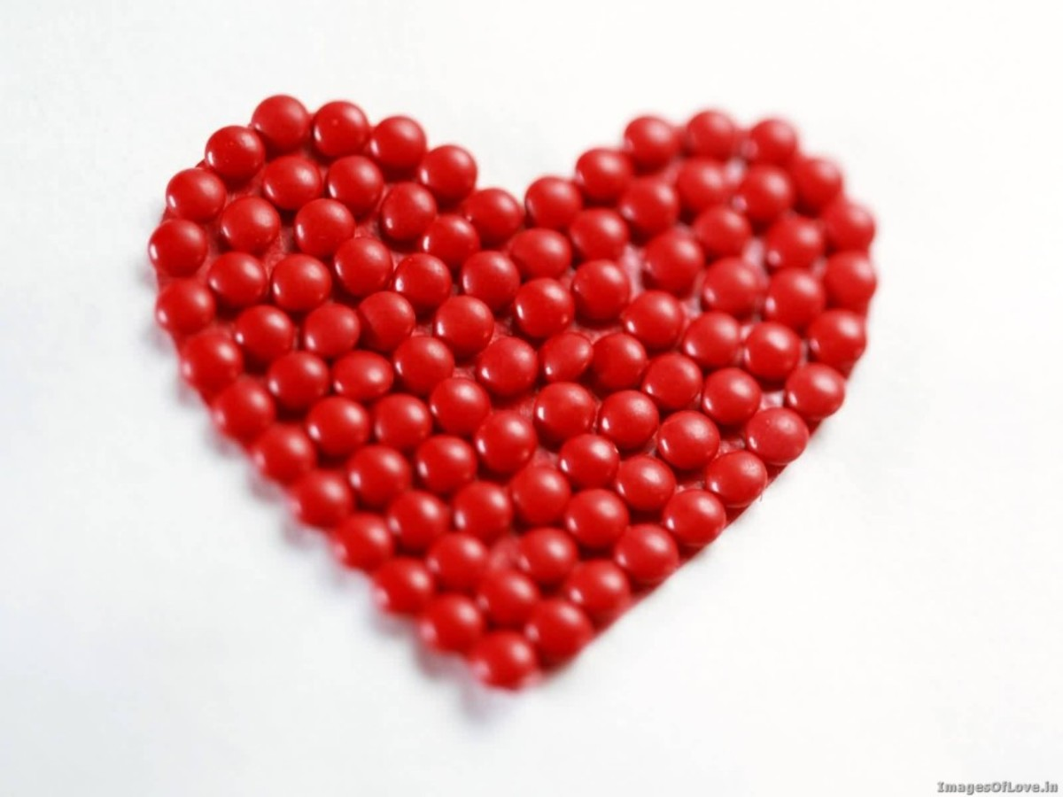 Red heart made of red beads