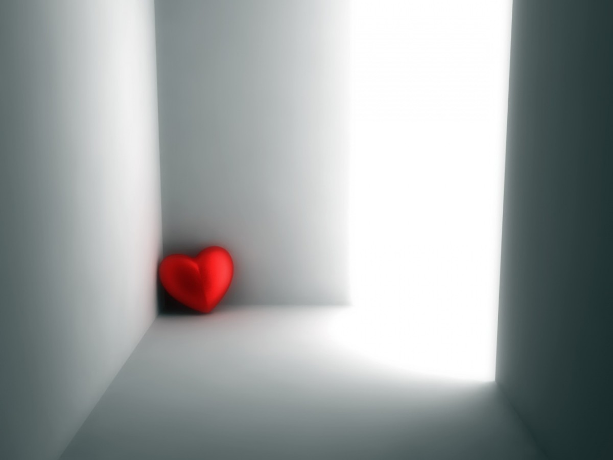 Picture of a single red heart sitting on a corner of the room