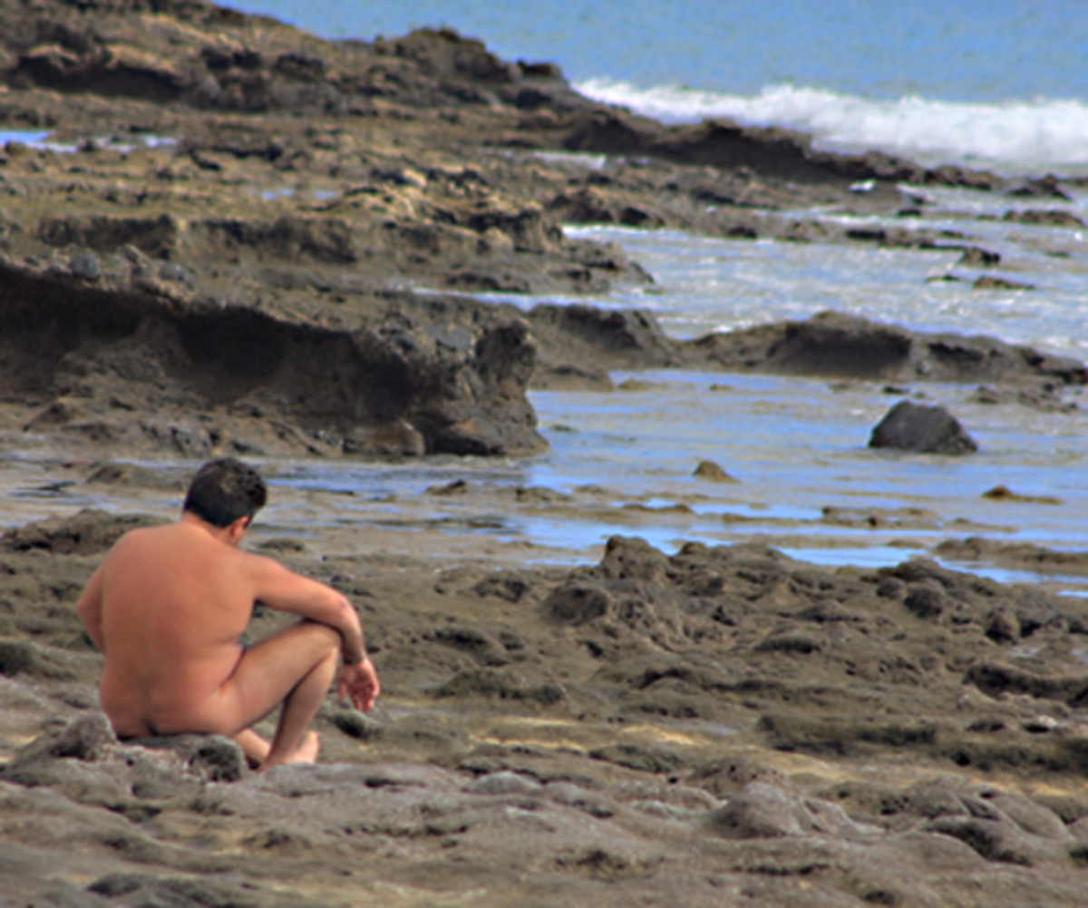 The all-over tan at Caleta del Congrio. However I'm not sure that sitting on those sharp-edged rocks looks to be quite as comfortable as sitting on the sand