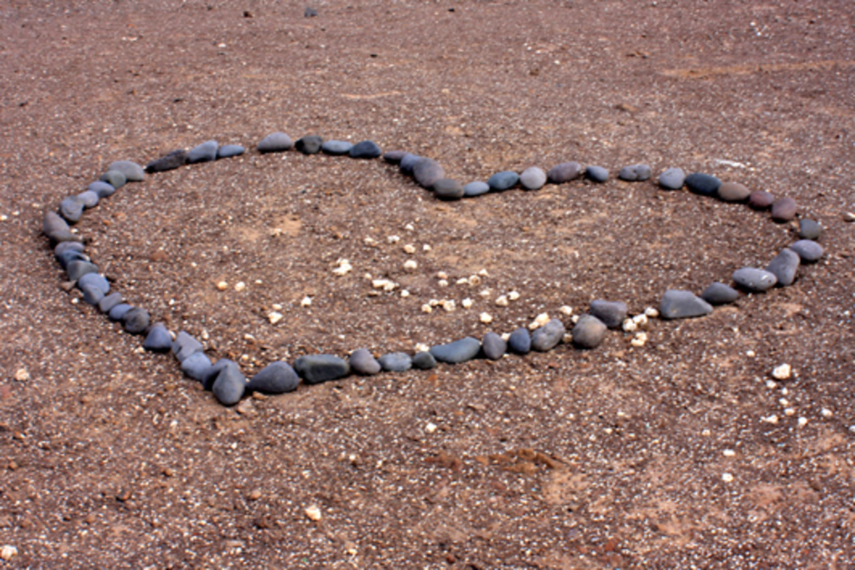 Lovers have a habit on the headlands of creating hearts out of stones