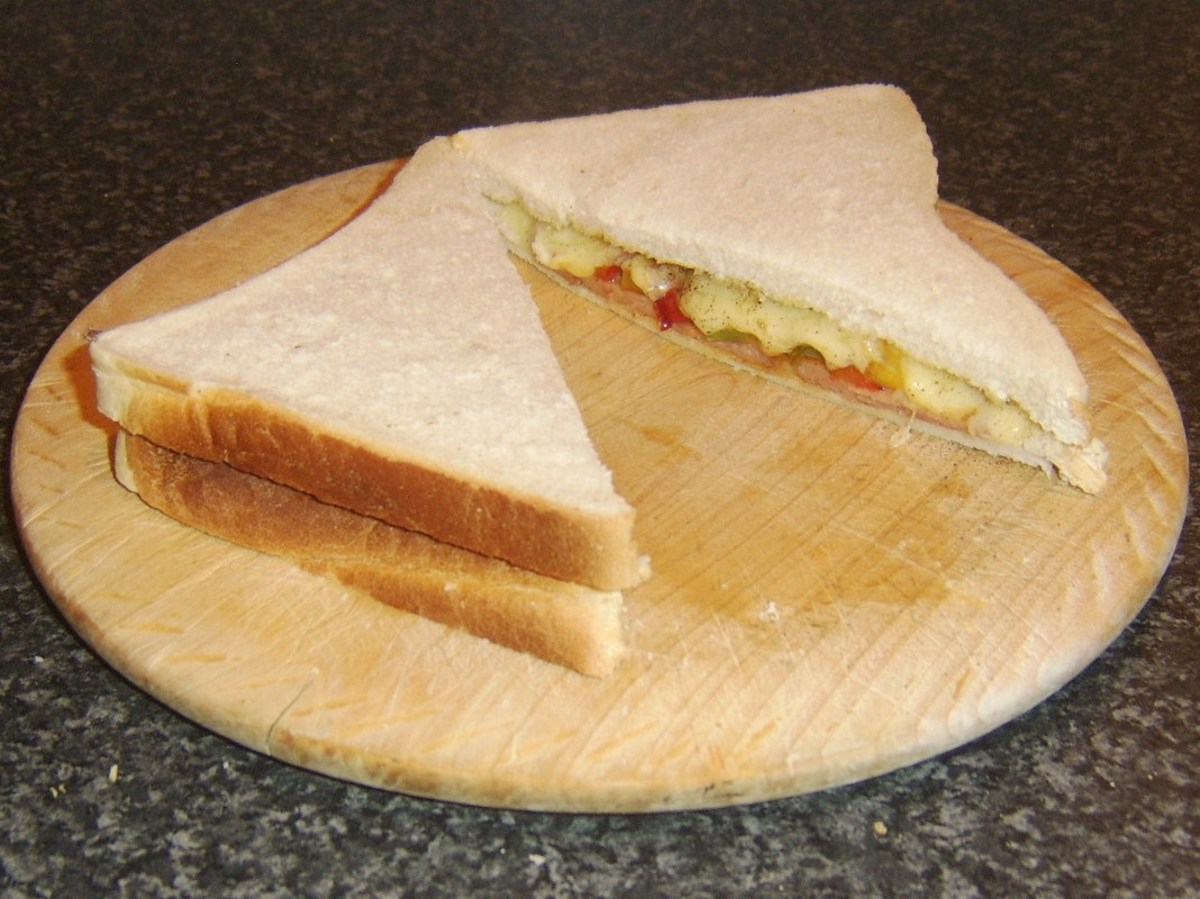 Spicy Spam, peppers and cheese sandwich is sliced to serve