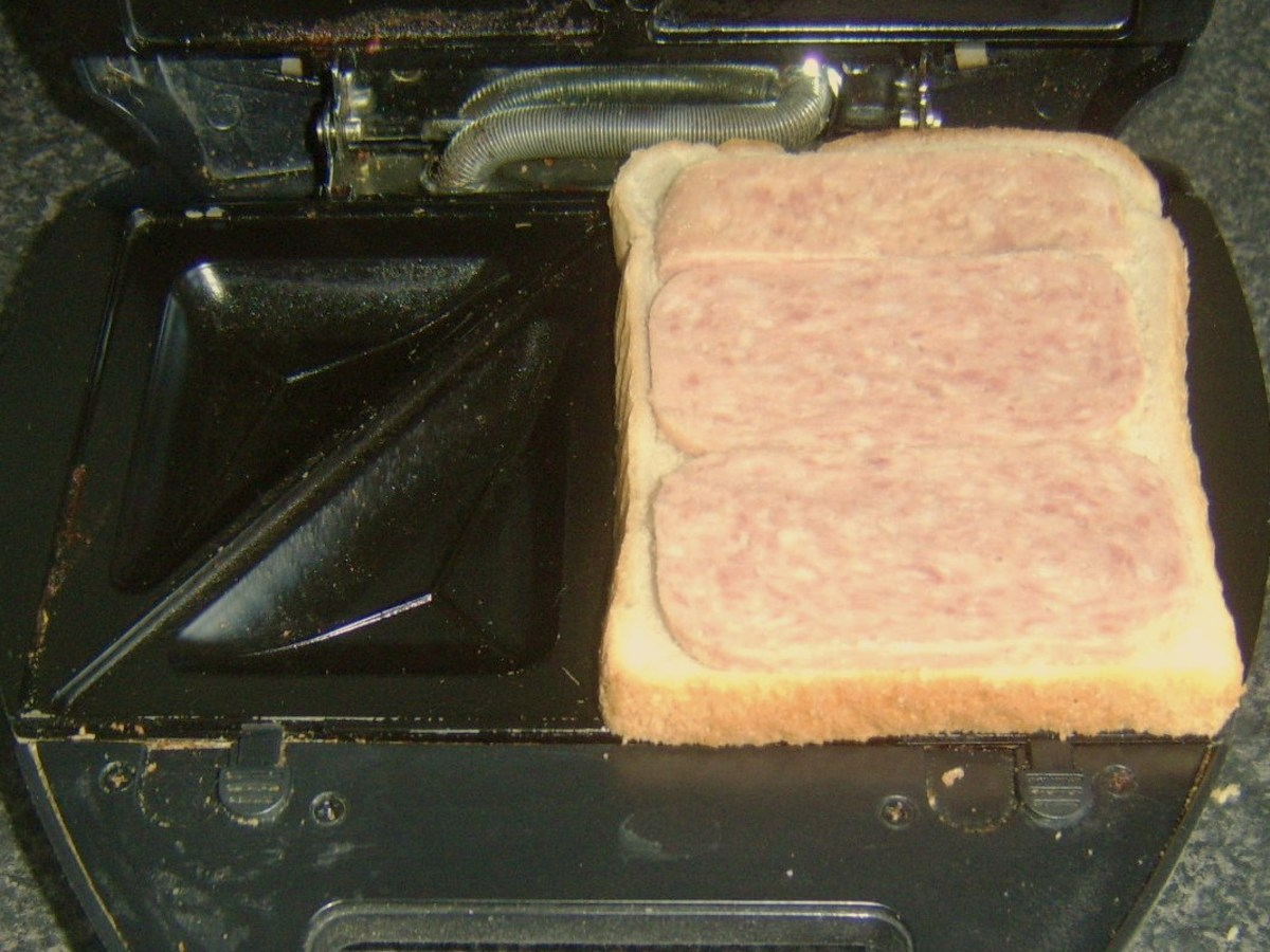 Starting to build toastie with Spam on bread