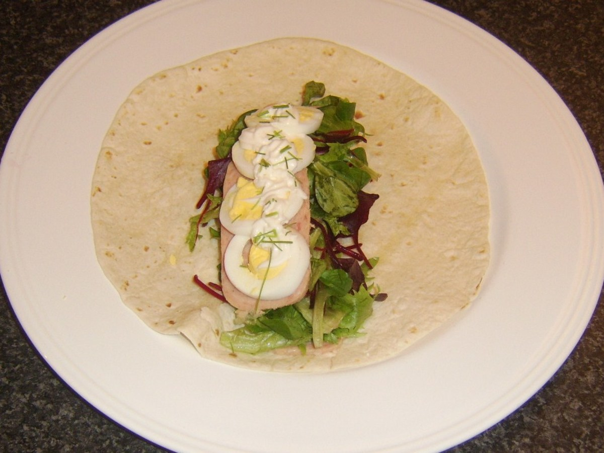Spam slices and salad leaves with hard boiled egg wrap