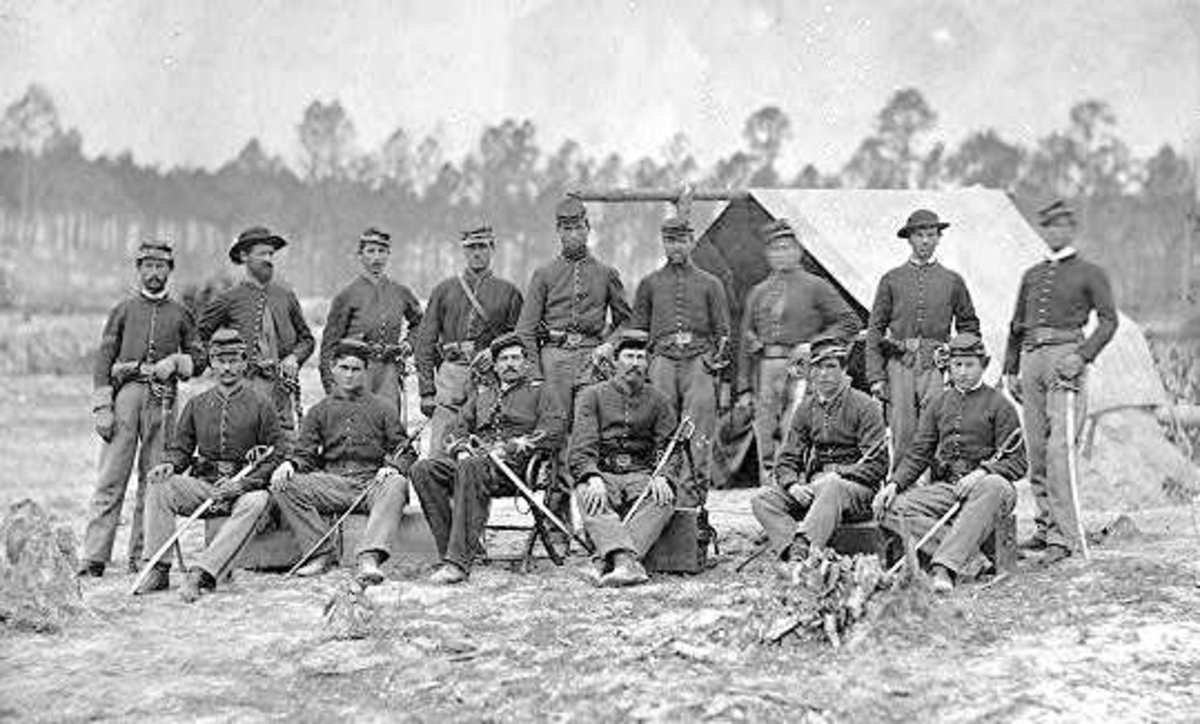 Cavalrymen, with sabers, of the 3rd IN Cavalry Volunteers pose for a photograph