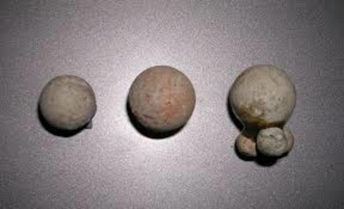 Smoothbore musket ammunition - the far right shows the ball and the buckshot pellets