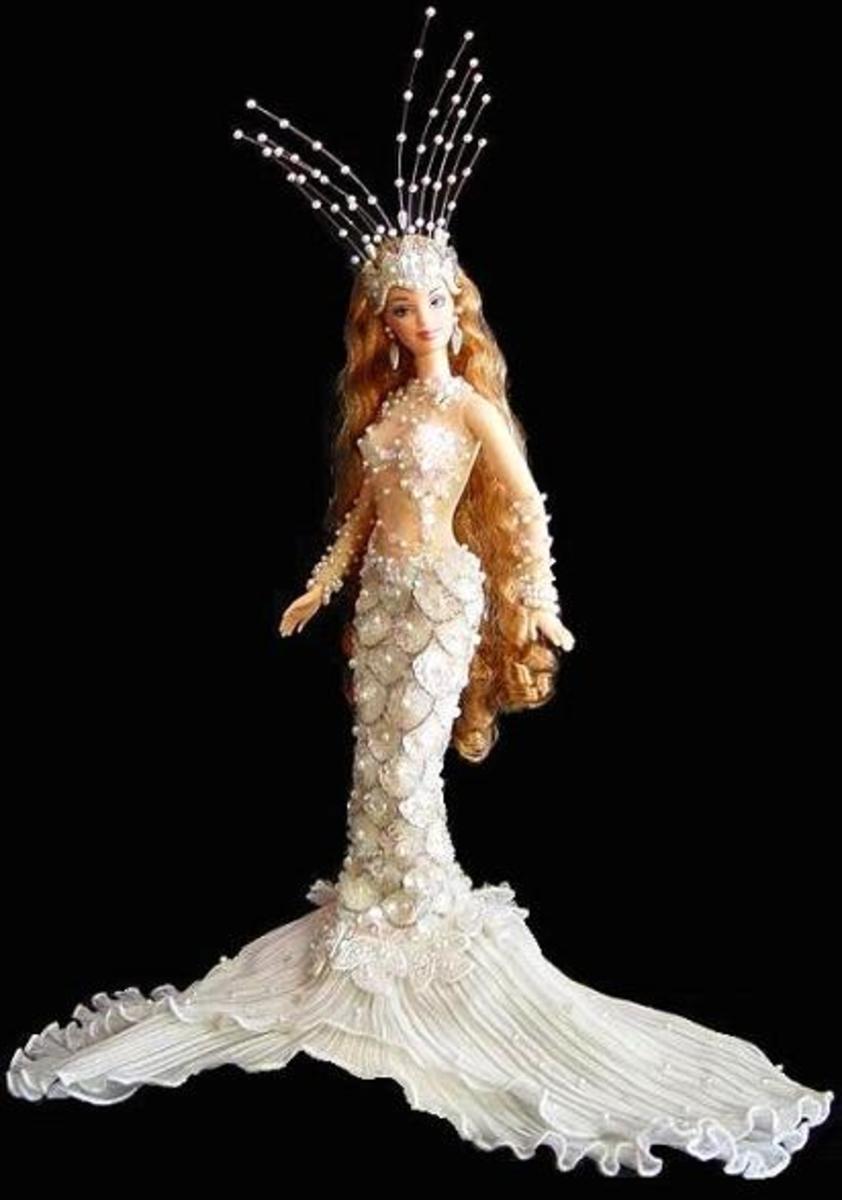 beautiful enchanged mermaid barbie doll in white sequins and pearl tiara