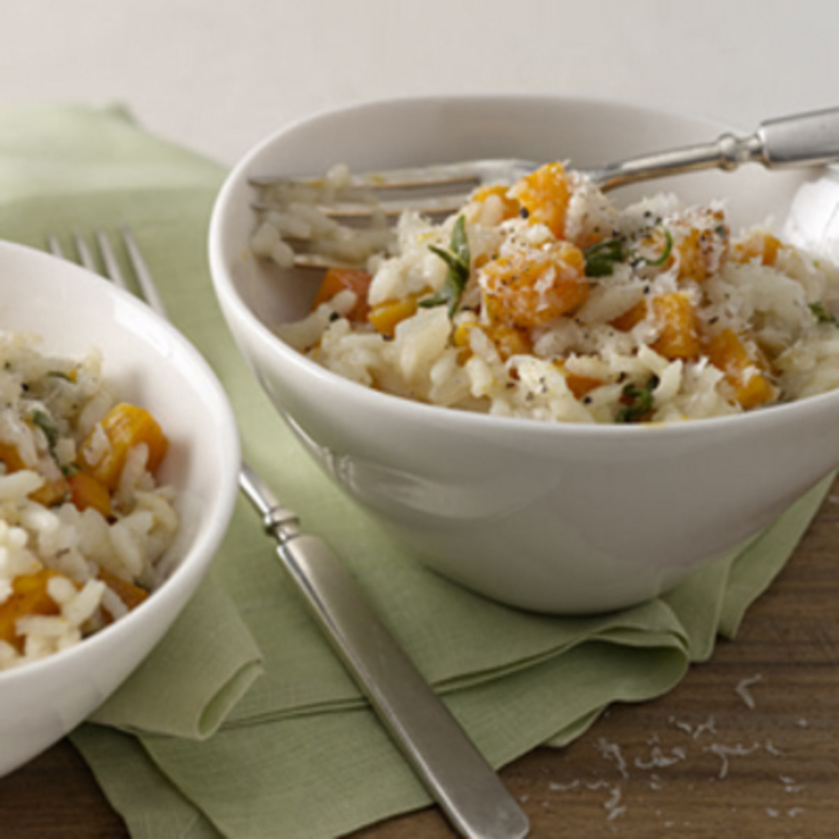 Sage is added to a butternut risotto dish.
