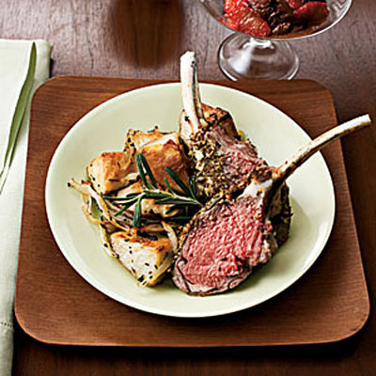 A fresh rosemary sprig is added to lamb chops.