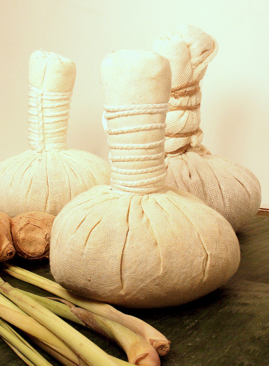 Herbal compresses consist of therapeutic herbs such as ginger, prai and turmeric wrapped in compress.