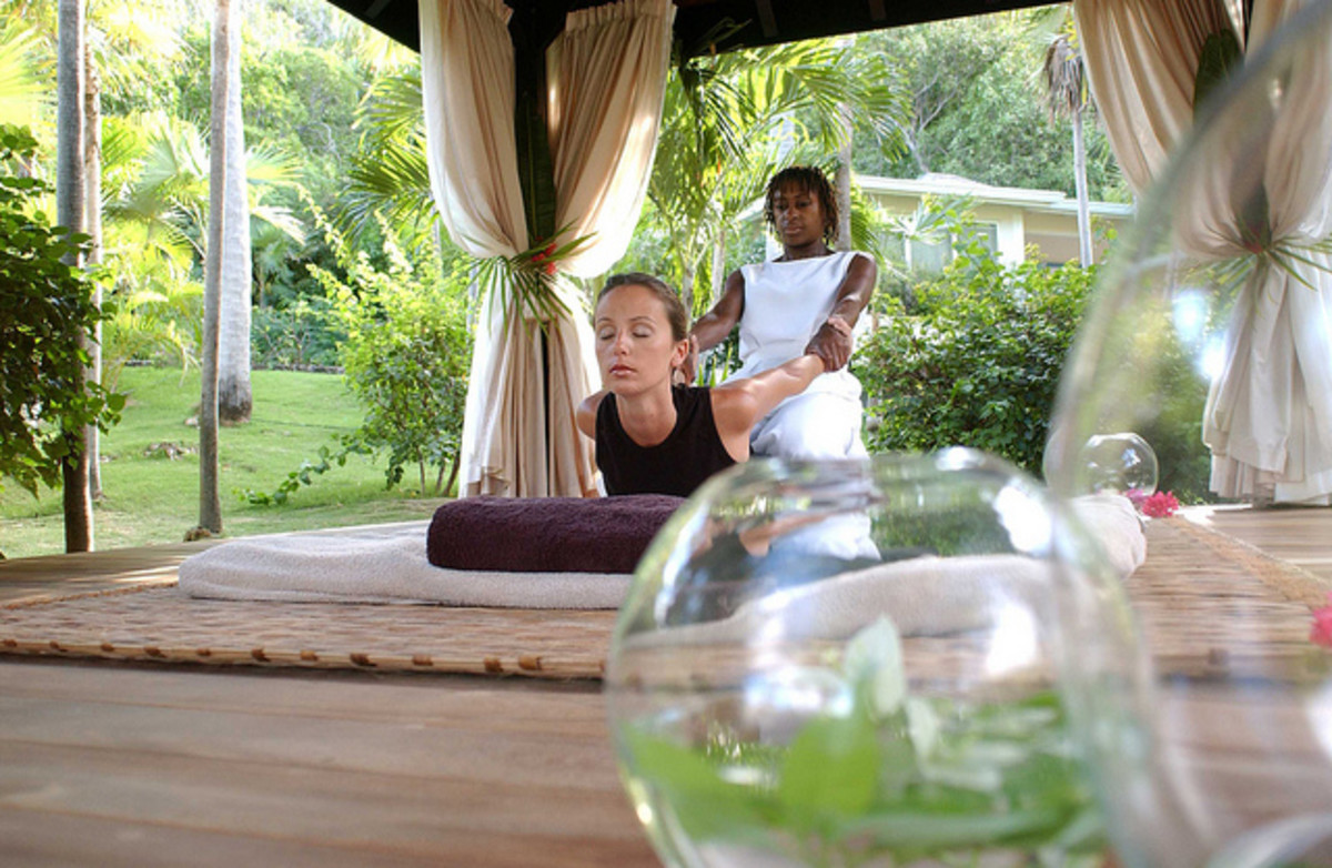 Various stretching techniques take place during a Thai massage session.