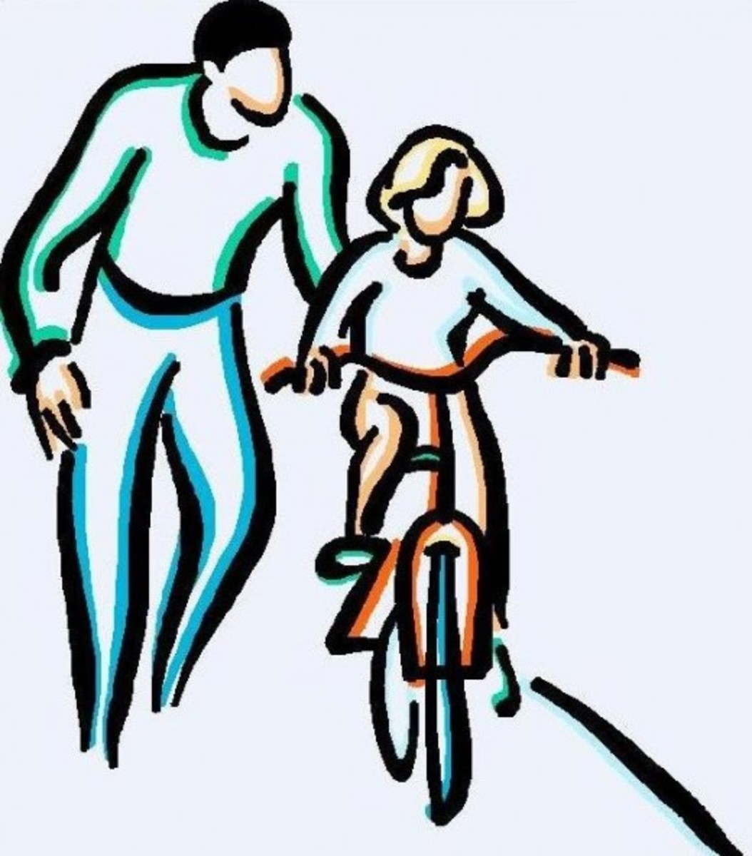 Dad Teaching Daughter to Ride Bicycle
