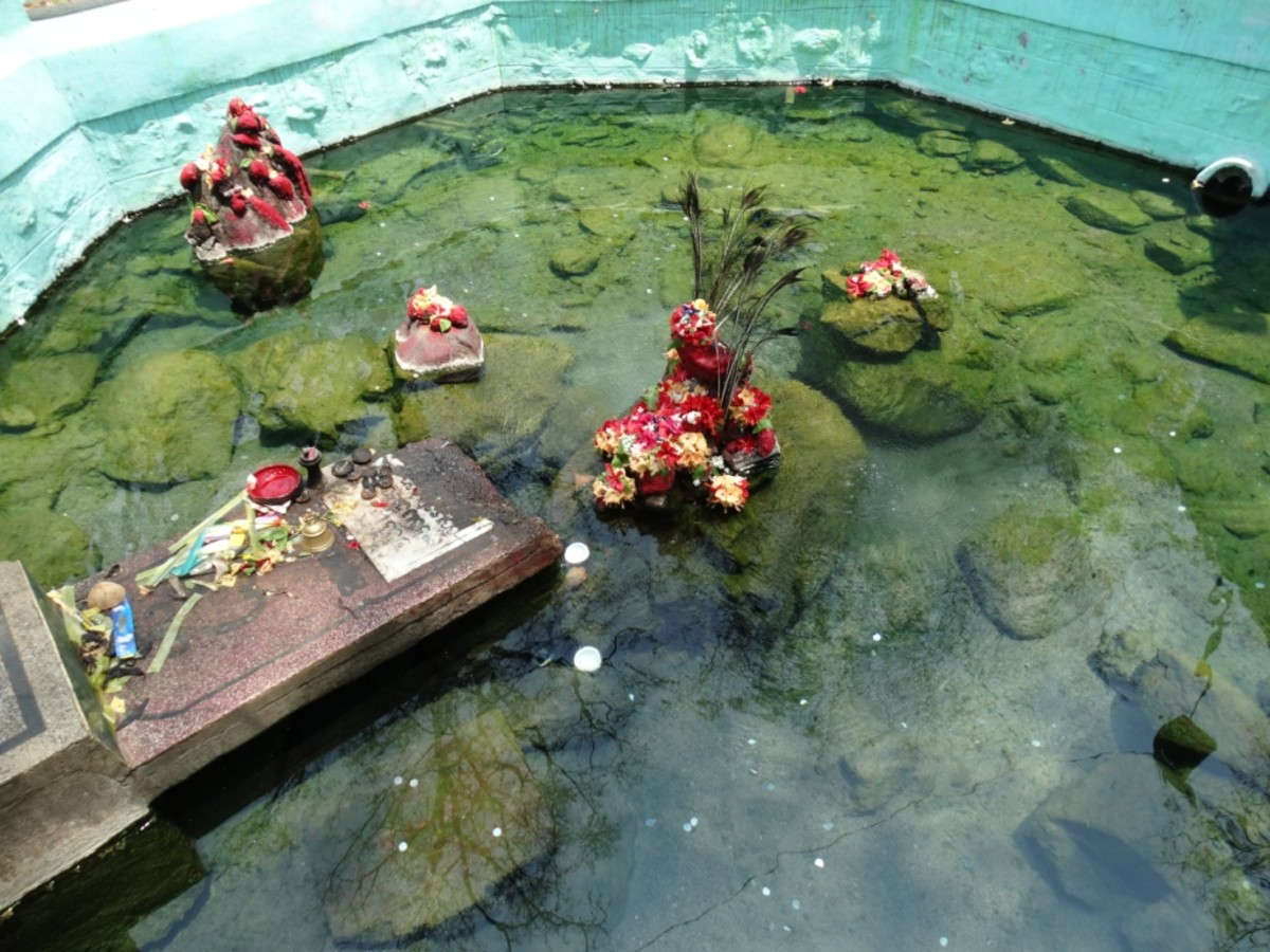 The hot spring with the idol of Kandhuni Mata at the centre of the Kund (pool) 2
