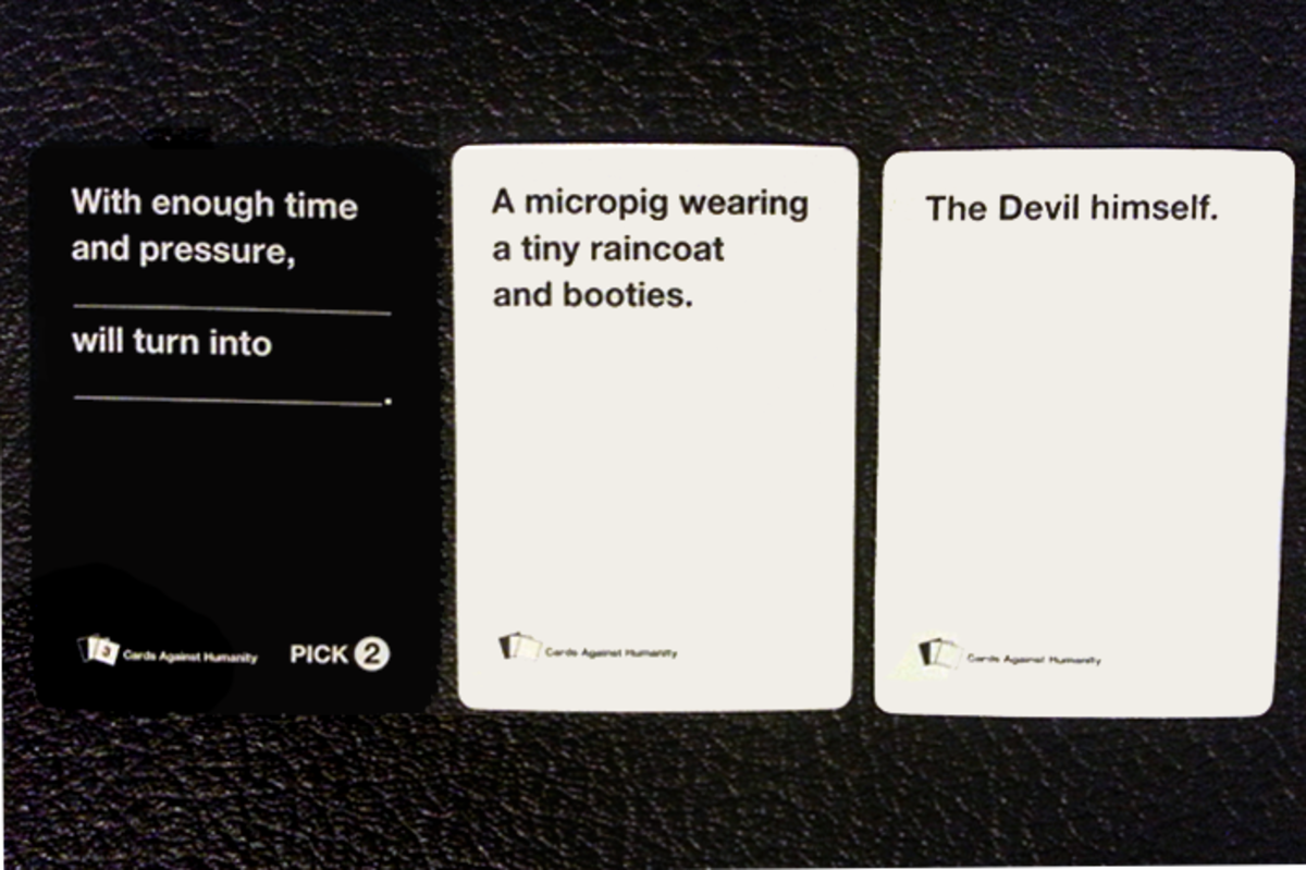 "An example of a hilarious combination of a ""Pick 2"" Black Card and two answer White Cards."