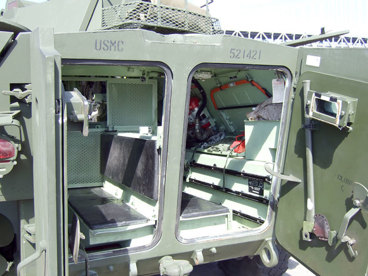 Interior shot of the rear passenger compartment where 2-4 Marine scouts could ride in.  Two Marines could stand on the benches and be half exposed out the rear roof hatches to provide overwatch and rear security.