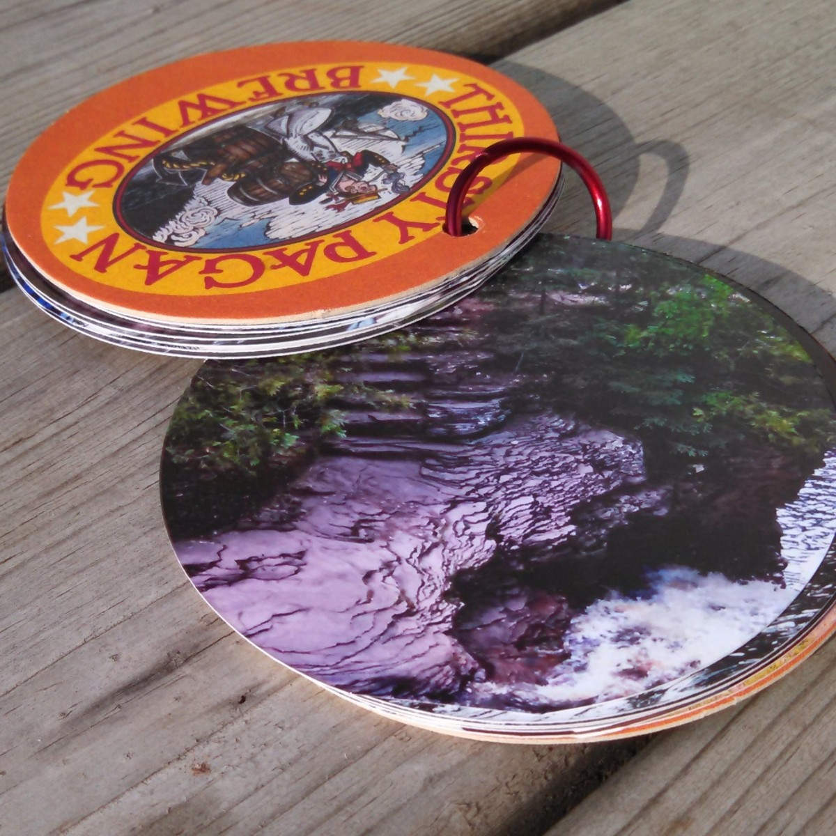 "The round shape and drink coaster ""covers"" make this a fun, functional memory album."