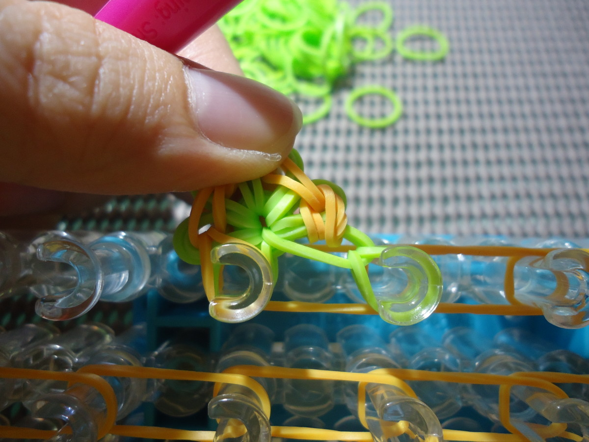 First stitch of the second Round. Notice that instead of working this stitch on the cap band, the stitch is worked on the first band of Round 1.