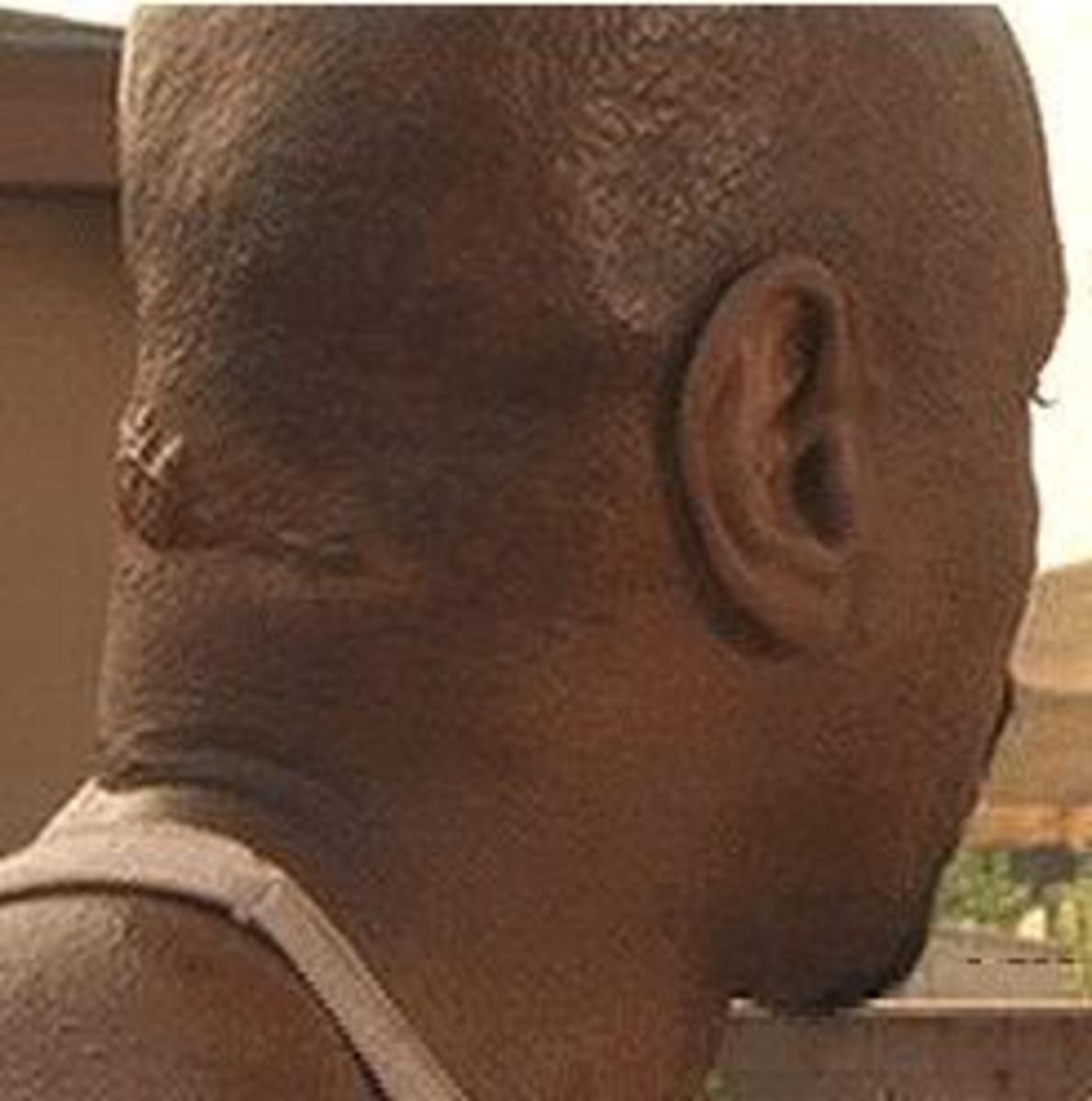 """A screenshot from the 2001 film """"Baby Boy"""" in which actor Ving Rhames reveals the actual scar on his neck"""