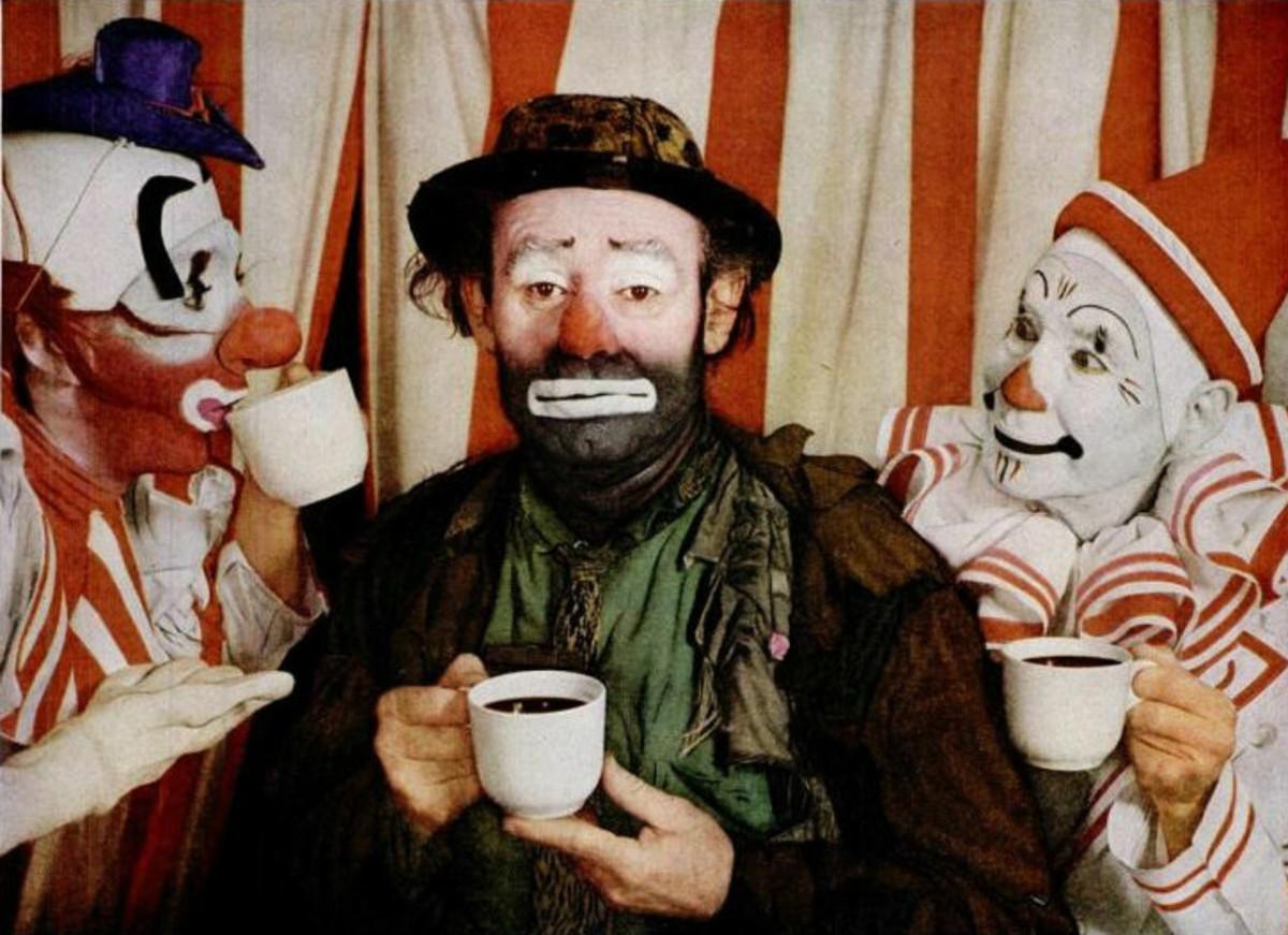 Emmett Leo Kelly: Three circus clowns drinking coffee.