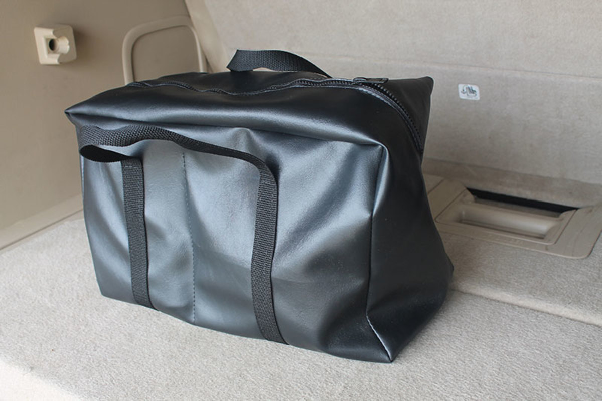 Soft side travel bag makes transport and storage of the old featherweight machines easy