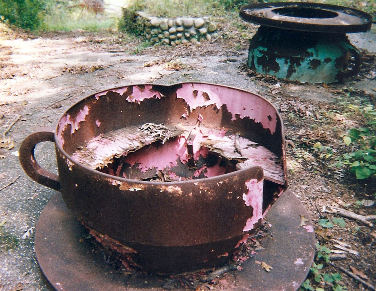 An old tea cup sits rusting in the dirt at the abandoned Enchanted Forest