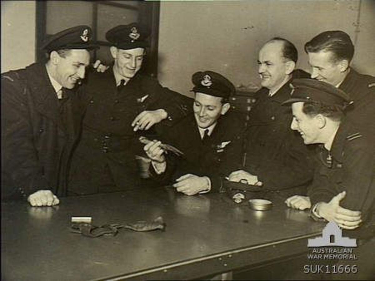 Group portrait of crew members of No. 466 Squadron. Left to right: Pilot Officer PO William Edmond Eagleton; PO Leslie Dean Anderson; PO Darrell William Cuthbert; Flt Lt Wilfred Guy Baldwin; PO John Devenish Chapman; Flt Lt Colin Osborne Chapman