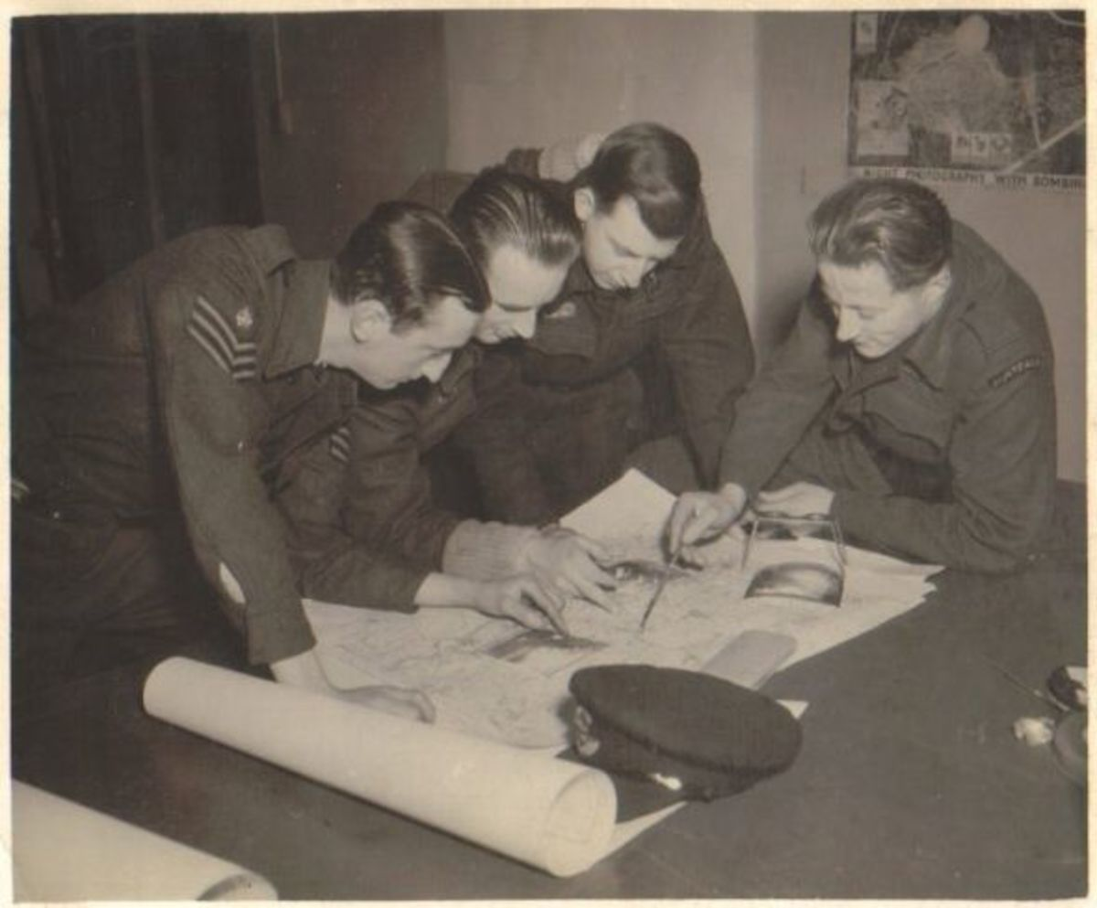 Photo: Taken at Leconfield, Yorkshire, England, probably during the latter part of 1943. Debriefing - L to R; unknown, Ron Last, Les Anderson, Geoff Coombes (crew 50).