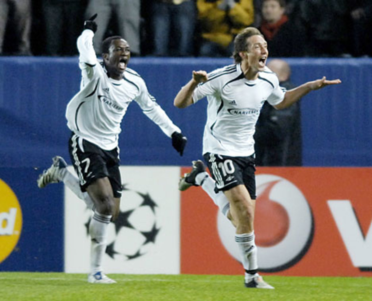 Yssouf Kone (7) and Vidar Riseth (10) celebrate during a UCL group stage match on Oct. 24, 2007. Both players scored the only of the match as Rosenborg won 2-0.