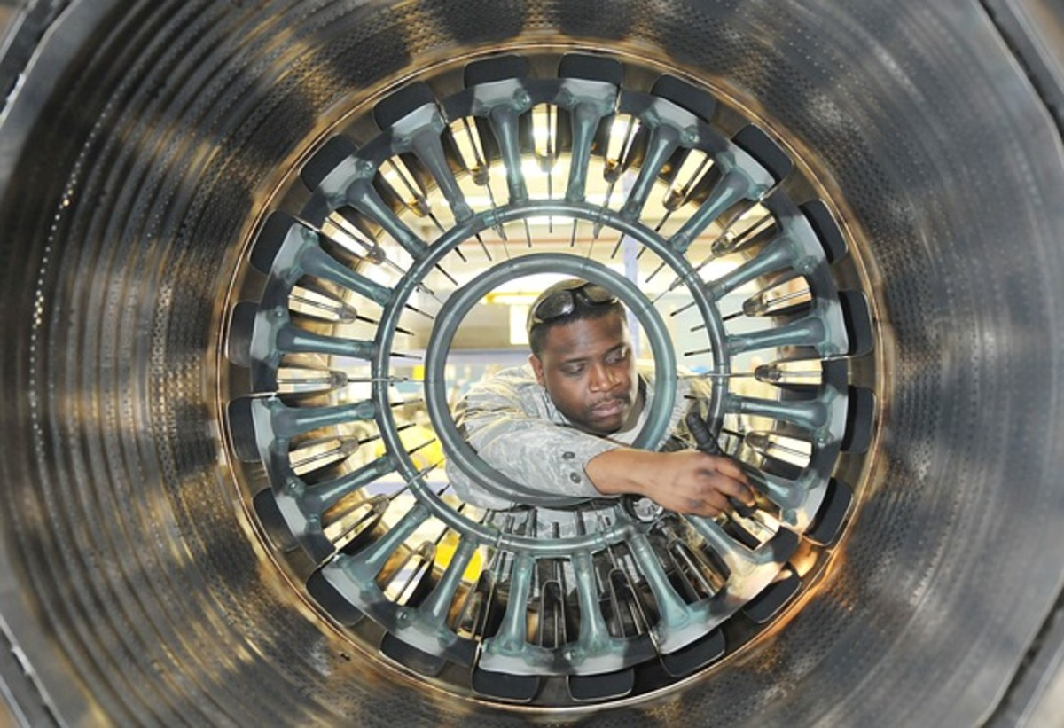 Man works on a jet engine.  Space exploration creates many high-tech jobs, most of them well paid.  In a world which is increasingly science and technology driven, space exploration can play a wider role in developing technologies.