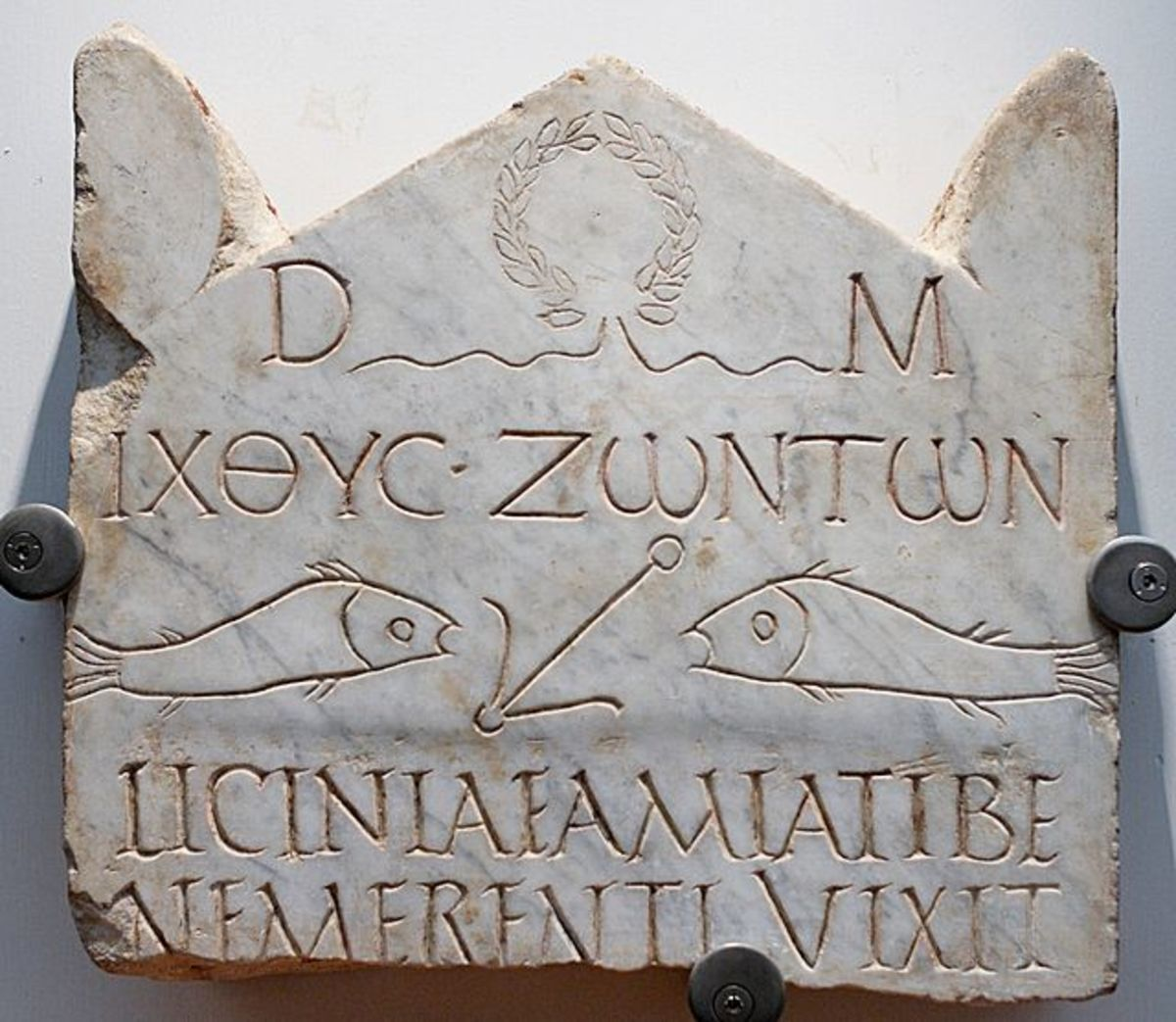 "The abbreviation D.M. at the top of this 3rd-century Christian tombstone stands for Diis Manibus, ""to the Spirits of the Dead"""