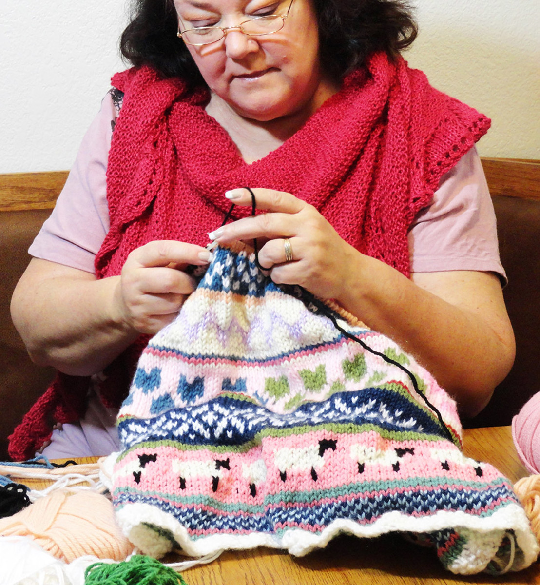 In this photo I am knitting a Fair Isle Baby Blanket for a grandchild.