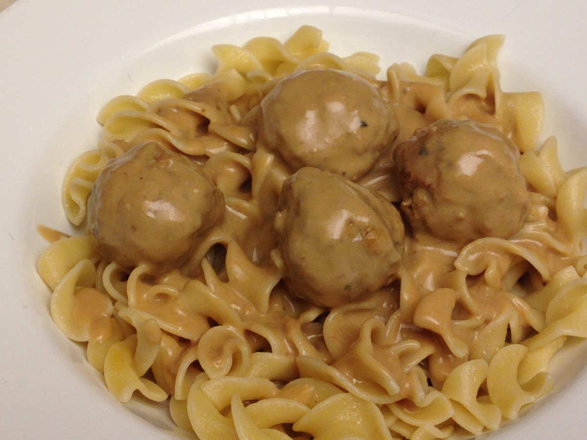 Swedish Style Meatballs with gravy with sour cream, served over noodles