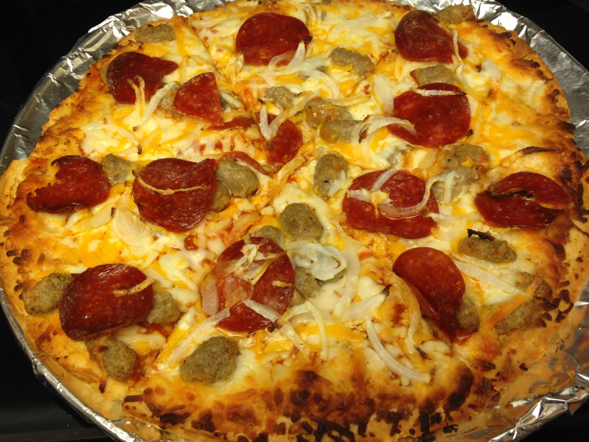 Schwan's Sausage and Pepperoni pizza, with a little onion added