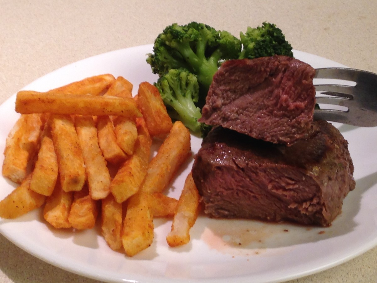Schwan's Filet Mignon with steamed broccoli and Zesty fries