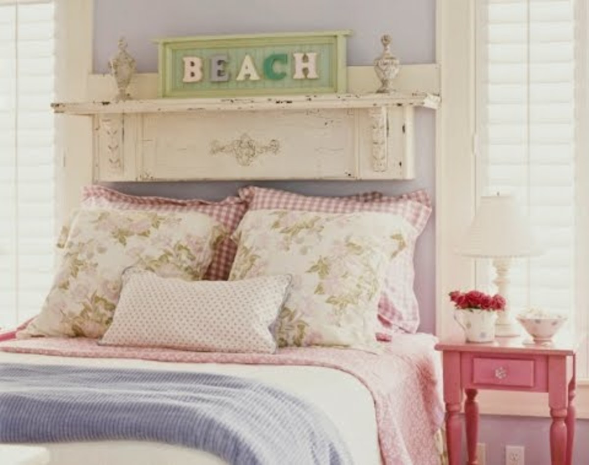 mini-shelf or plate rail above a bed holding a country cottage chic plate for coastal charm - labelled beach