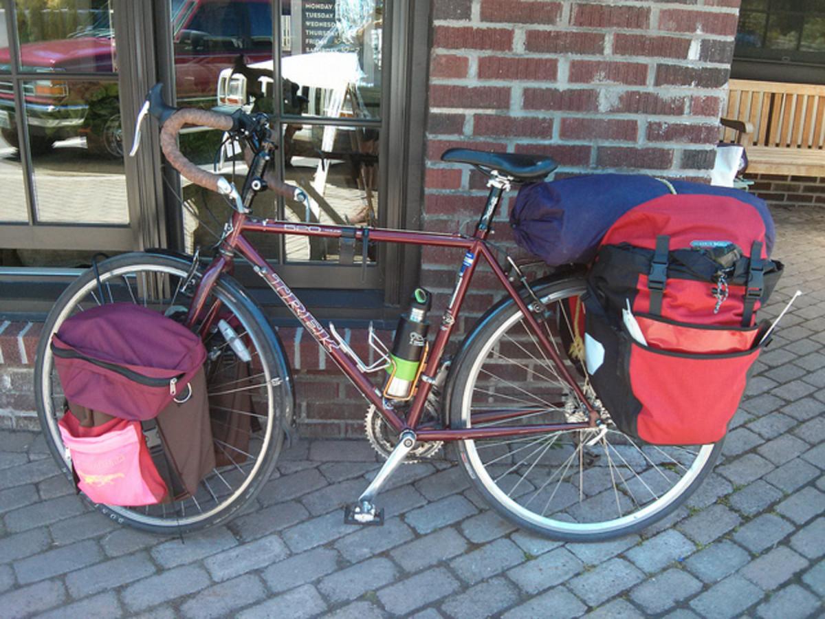 A Trek 520 road bike fully loaded.
