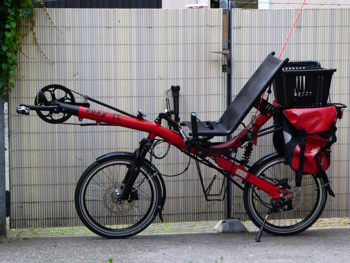 A Recumbent two wheel bicycle with saddle bags.