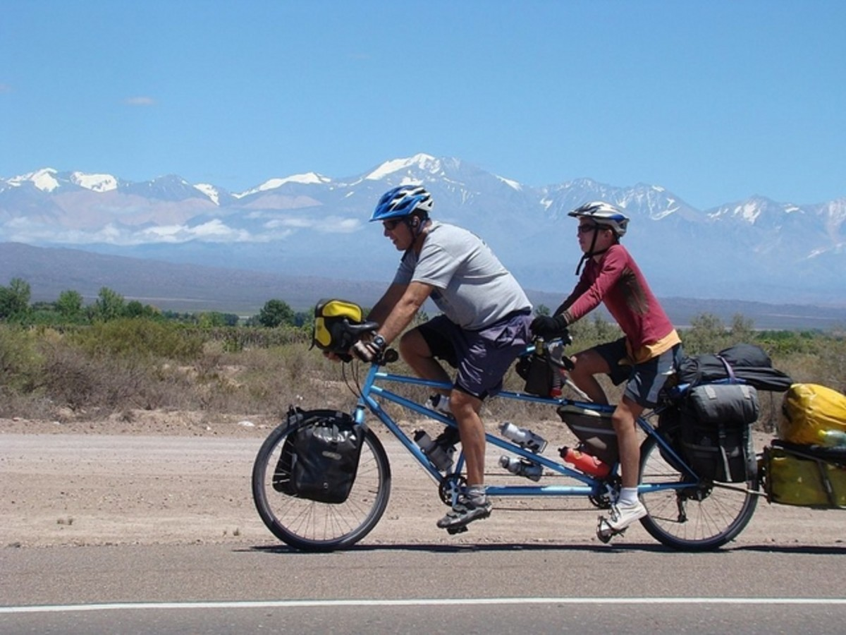 A tandem bicycle fully loaded.