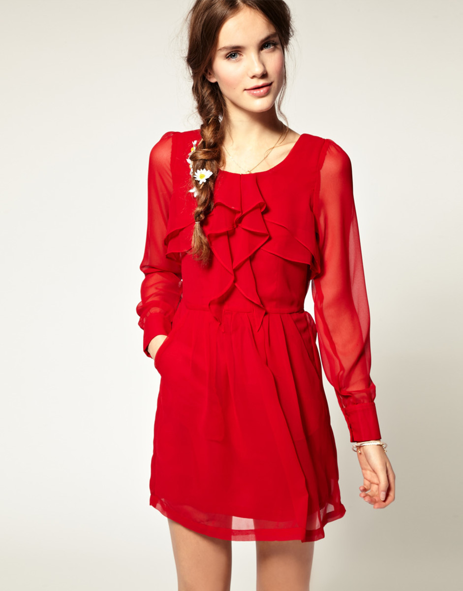 Long sleeved red sheer frilly dress