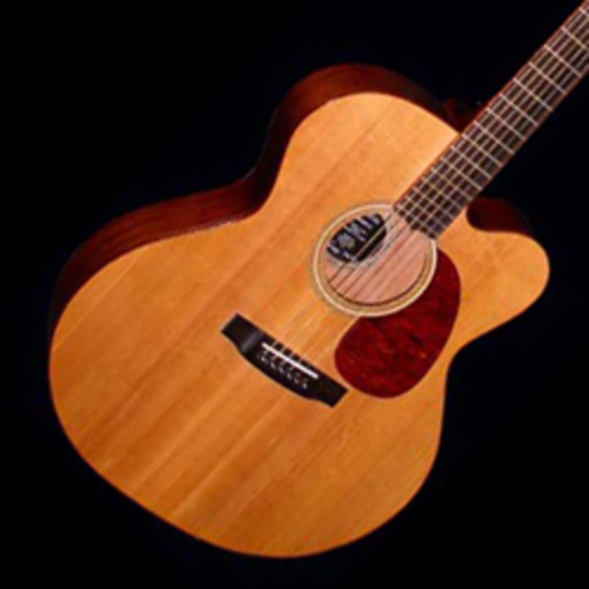Acoustic guitar with a 'cutaway'. The indentation allows easier access to the upper frets on the treble strings.