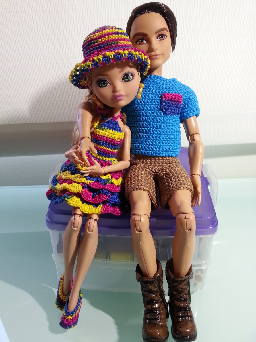 Ashlynn Ella and Hunter the Hunstman sitting in their new clothes.