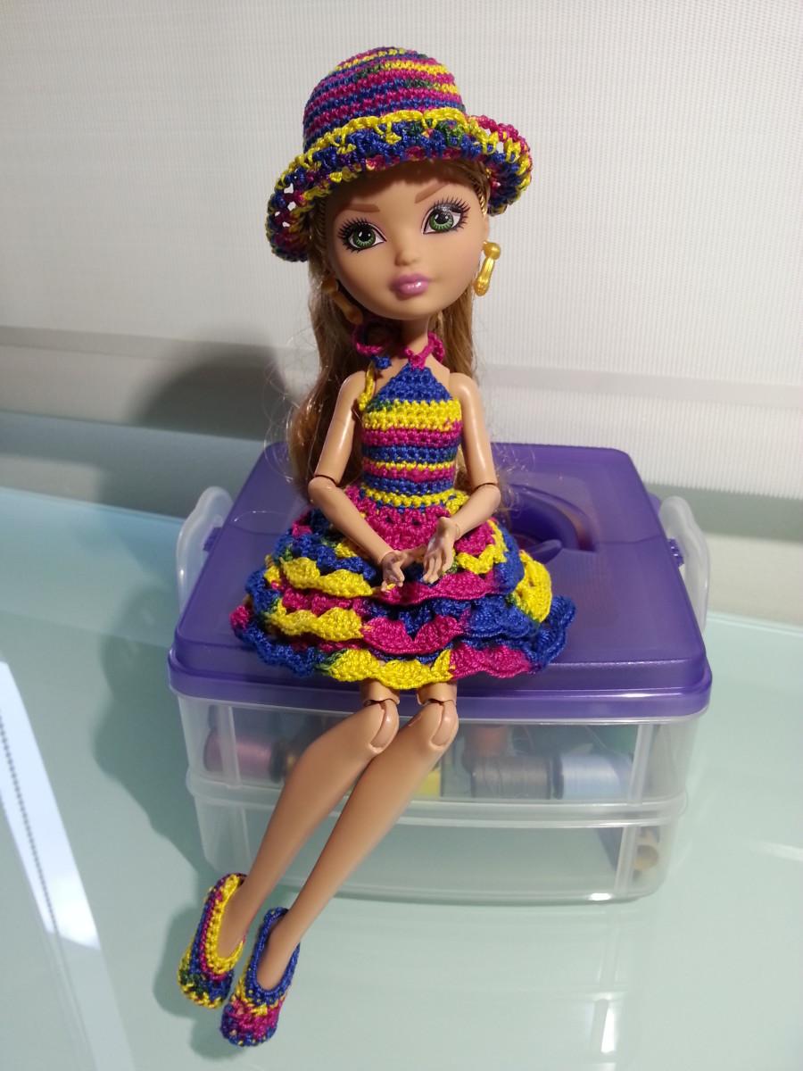 Ashlynn Ella in Ruffled Cocktail Dress, Ballet Flats, and Summer Hat.