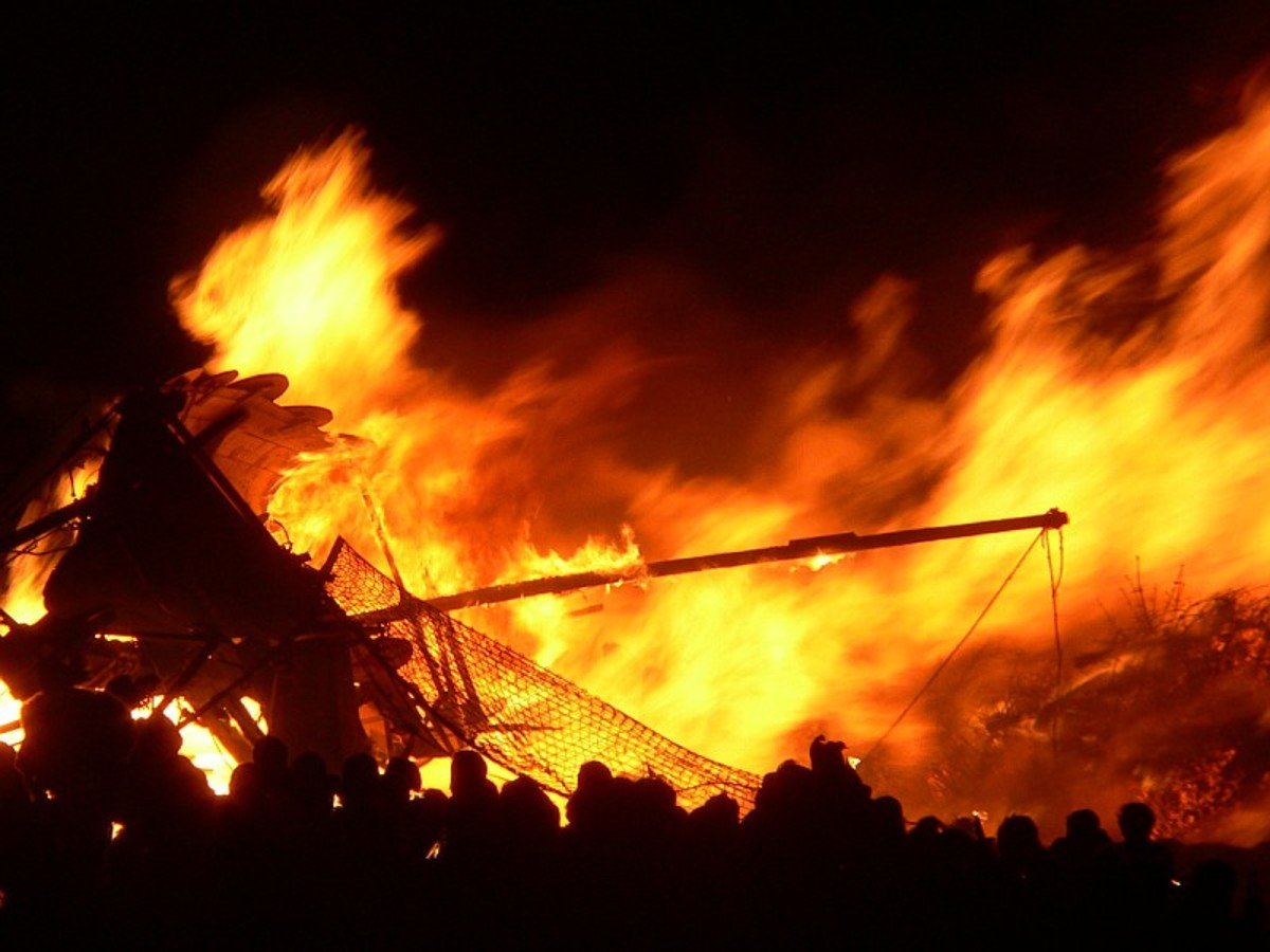"""A Norse Longship is burned during the Edinburgh Hogmanay festival, where the Up Helly Aa """"vikings"""" of Orkney help lead the procession with torches."""
