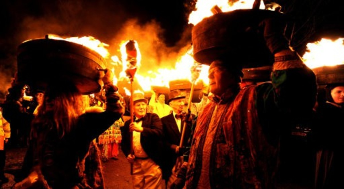 Allendale in Northumberland, sees a procession of flaming barrels of tar paraded through the streets to drive the evil spirits away. They are then thrown onto a bonfire.