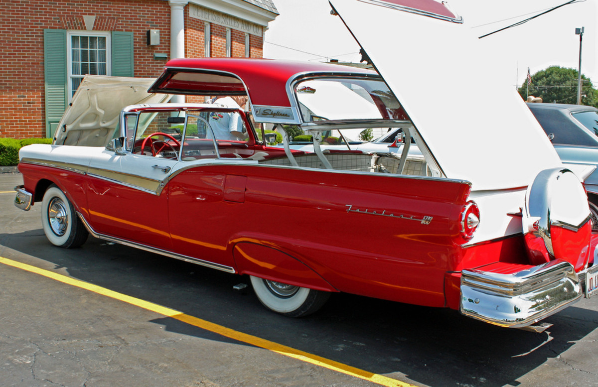 1957 Ford Fairlane 500 Skyliner convertible hardtop. Red and White.