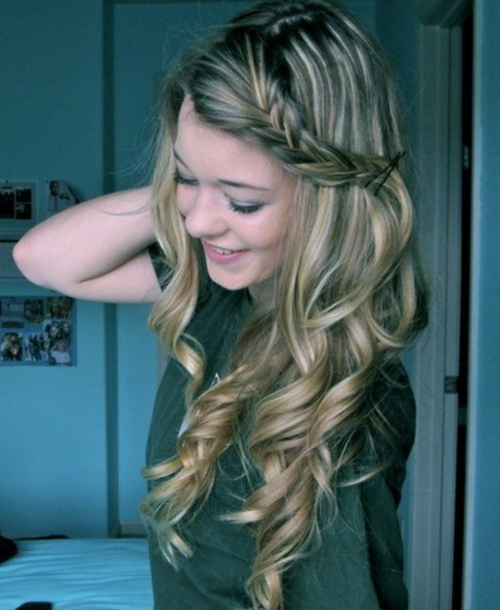 Side-swept braided curly hairstyle