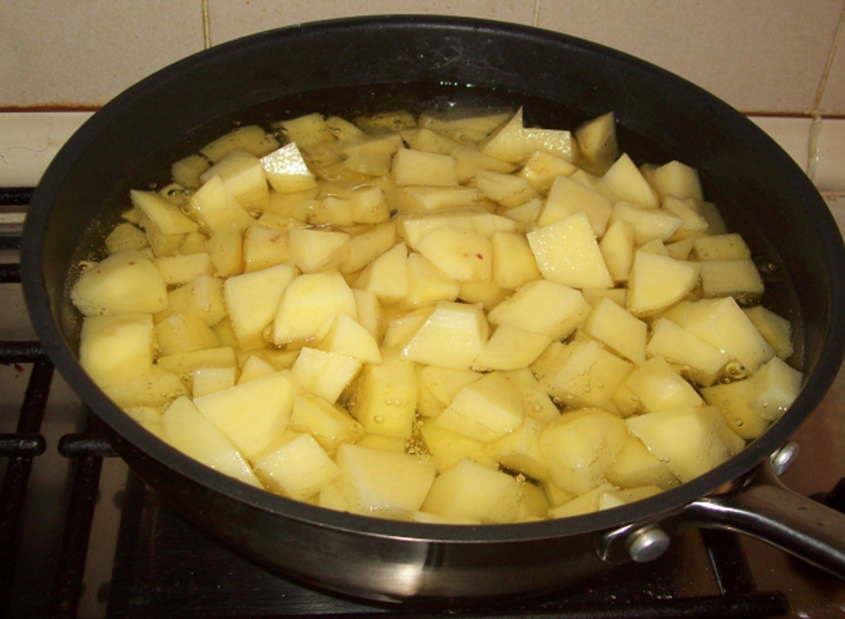 I use rape seed oil in a clean pan to slowly fry the potatoes for about 15 mins.