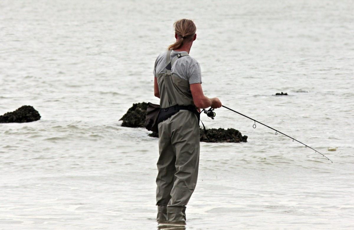 Angler doing surf fishing at his favorite North Sea coastline..