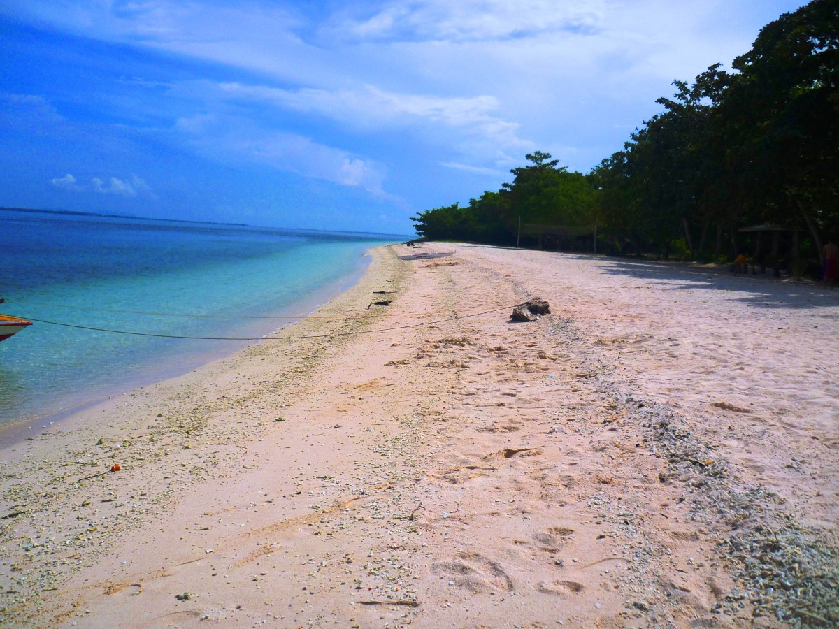 This hidden treasure is the ONLY pink beach in the Philippines