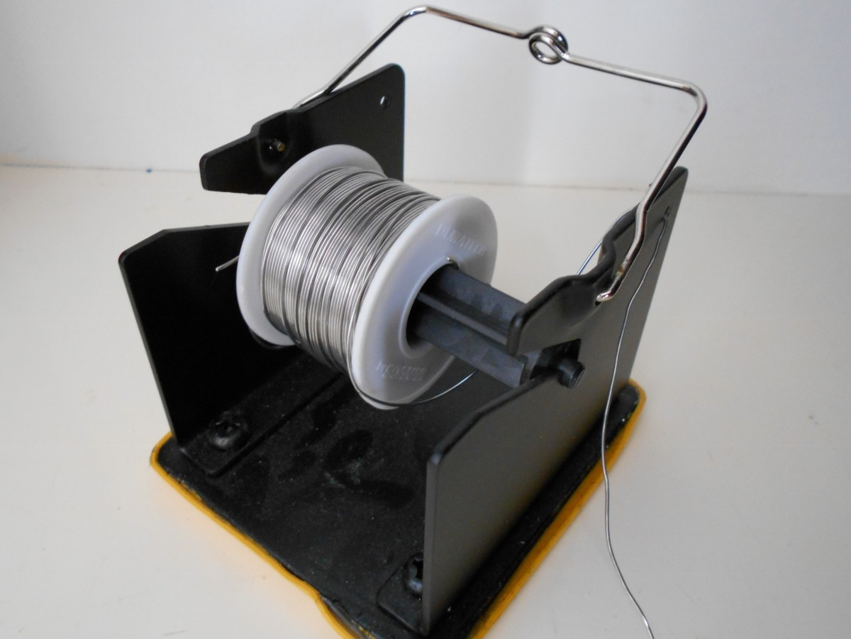A roll of solder wire on a stand. The stand alone costs around $18 without the roll of solder wire.